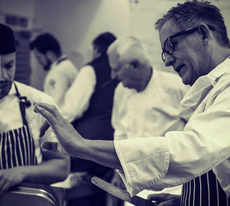 Two chefs talking while in the kitchen at Worcester Racecourse.