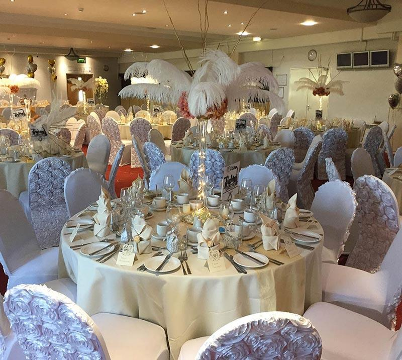 A large room at Worcester Racecourse prepared for guests to arrive for the wedding.