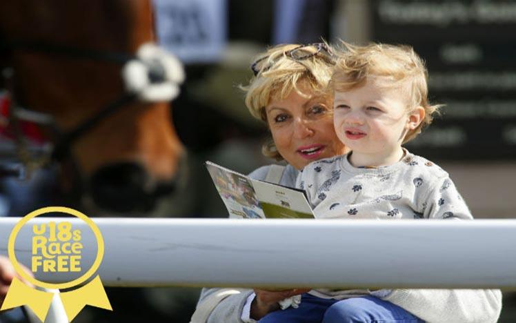 A mother and child enjoy a dasy racing